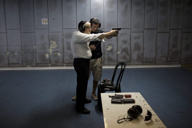 An Ultra Orthodox Jewish man practices his shooting skill at a shooting range in Jerusalem, Israel, 19 October 2015. Local media report of an increase in weapon permit applications from Israeli citizens due to the tense security situation and the recent attacks on Israelis. Israeli Public Security Minister Gilad Erdan had approved guidlines to ease the rules to issue gun permits to Israelis. (Photo by Abir Sultan/EPA)
