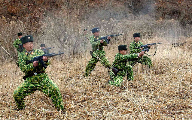 North Korean soldiers with weapons attend military training in an undisclosed location in this picture released by the North's official KCNA news agency in Pyongyang March 11, 2013. South Korea and U.S. forces are conducting large-scale military drills until the end of April, while the North is also gearing up for a massive state-wide military exercise. North Korea has accused the U.S. of using the military drills in South Korea as a launch pad for a nuclear war and has threatened to scrap the armistice with Washington that ended the 1950-53 Korean War. (Photo by KCNA/Reuters)