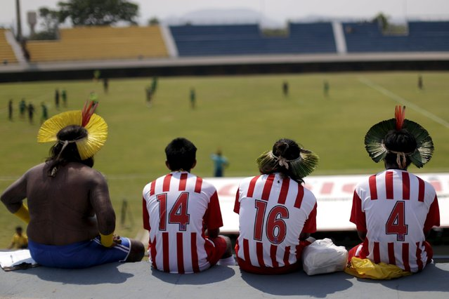 Indigenous people from the Kayapo tribe watch a soccer match during the I World Games for Indigenous People in Palmas, Brazil, October 22, 2015. (Photo by Ueslei Marcelino/Reuters)