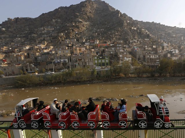 Afghans take a ride at City Park, the first amusement park in Kabul November 28, 2014. (Photo by Mohammad Ismail/Reuters)