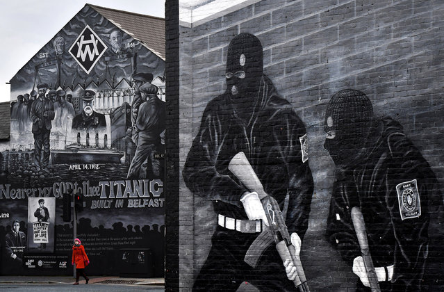 A woman crosses the street against the backdrop of the John Stewart painted mural dedicated to the men, women and children who lost their lives on the Titanic on March 1, 2018 in Belfast, Northern Ireland. (Photo by Charles McQuillan/Getty Images)
