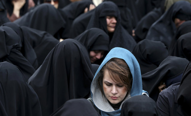 Iranian women attend a mourning ceremony marking the death anniversary of Fatima, the daughter of Islam's Prophet Muhammad, in Tehran, Iran, Sunday, April 14, 2013. (Photo by Ebrahim Noroozi/AP Photo)