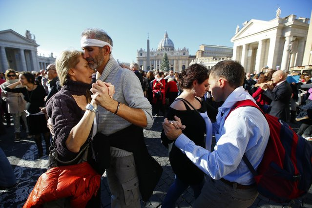 Couples dance a tango in front of Saint Peter's basilica at the Vatican, December 17, 2014. (Photo by Tony Gentile/Reuters)
