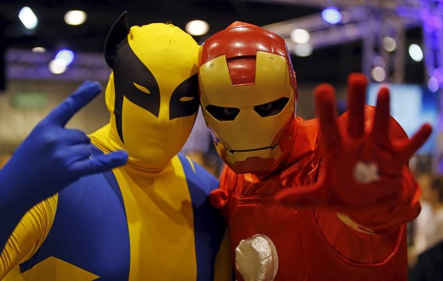 Participants wearing superhero costumes pose for a picture during the second edition of the Hero Festival in Marseille, France November 7, 2015. (Photo by Jean-Paul Pelissier/Reuters)