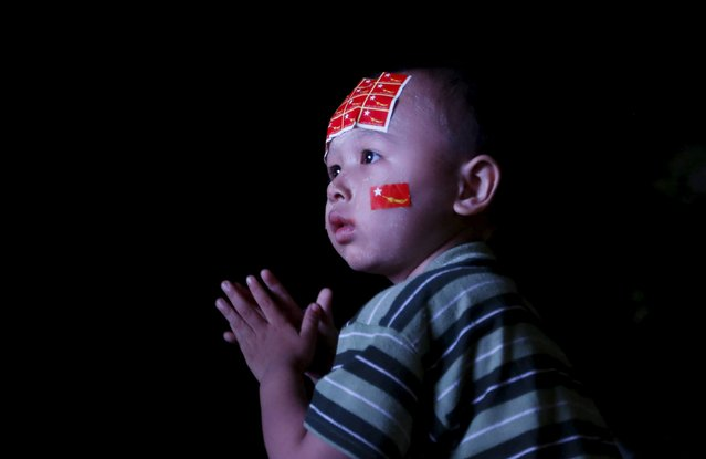 A young boy looks at a TV monitor showing polling results at the offices of opposition leader Aung San Suu Kyi's National League for Democracy (NLD) after the general election in Mandalay, Myanmar, November 9, 2015. (Photo by Olivia Harris/Reuters)