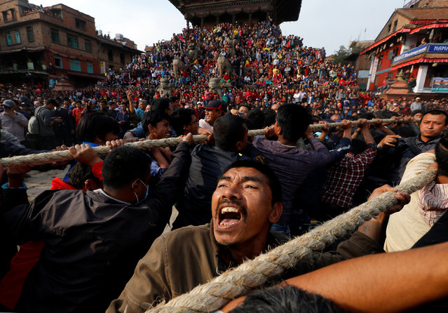 Devotees pull the chariot of God Bhairab during the Biska Festival also known as Bisket Festival in Bhaktapur, Nepal April 10, 2018. (Photo by Navesh Chitrakar/Reuters)