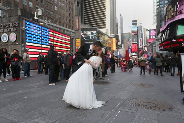 Berta and Jose Fernandez from Spain pose for wedding photos in Times Square in the Manhattan borough of New York November 11, 2015. (Photo by Carlo Allegri/Reuters)