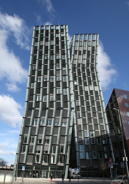 "An outside view shows the ""Dancing Towers"" (Tanzende Tuerme), a new architectural landmark and office building by Hadi Teherani in Hamburg, northern Germany on April 4, 2013. The building complex was officially openened on April 4, 2013, hosting a radio station, a night club, a hotel, a restaurant and various offices right in the heart of Hamburg's red light district. (Photo by Christian Charisius/AFP Photo)"