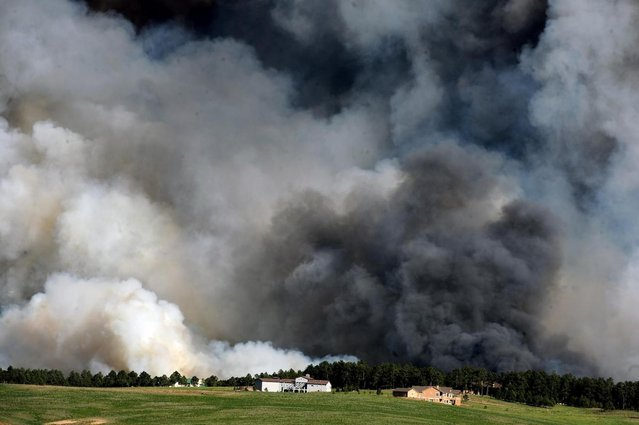 Large plumes of smoke rise from a wild land fire in the Black Forest northeast of Colorado Springs, Colo. on Tuesday, June 11, 2013.  Homes have already burned and the wind is expected to continue through the afternoon. (Photo by Helen H. Richardson/AP Photo/The Denver Post)