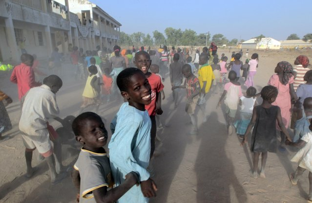 Children displaced as a result of Boko Haram attacks in the northeast region of Nigeria, run at a camp for internally displaced persons (IDP) in Yola, Adamawa State January 13, 2015. Boko Haram says it is building an Islamic state that will revive the glory days of northern Nigeria's medieval Muslim empires, but for those in its territory life is a litany of killings, kidnappings, hunger and economic collapse. (Photo by Afolabi Sotunde/Reuters)