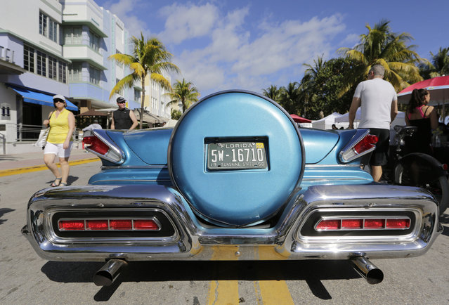 A 1958 Mercury is on display with other antique vehicles at the Art Deco Weekend festival, Sunday, January 18, 2015, in Miami Beach, Fla. The festival is held along Ocean Drive and celebrates the style and art deco inspired architecture that South Beach is known for. (Photo by Lynne Sladky/AP Photo)