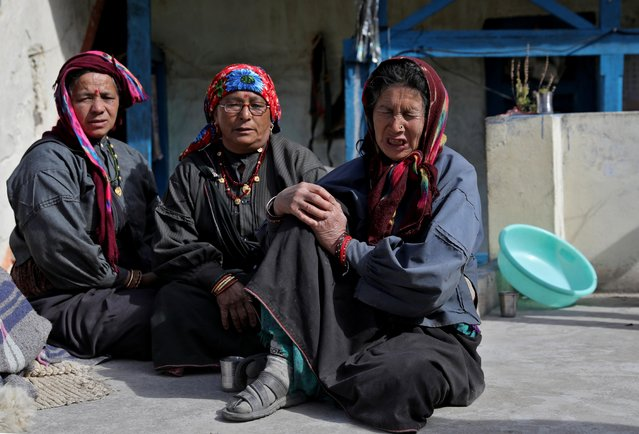Yashoda Devi, 66, mother of 33-year-old Yashpal Rana, who went missing after a flash flood swept a mountain valley destroying dams and bridges, weeps outside her house at Raini Chak Lata village in Chamoli district, in the northern state of Uttarakhand, India, February 12, 2021. (Photo by Anushree Fadnavis/Reuters)