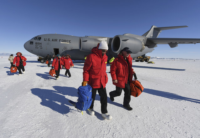 US Secretary of State John Kerry, center, disembarks from a U.S. Air Force C17 Globemaster with National Science Foundation's Scott Borg, right, at the Pegasus ice runway near McMurdo Station, Antarctica, Friday,  November 11, 2016. (Photo by Mark Ralston/Pool Photo via AP Photo)