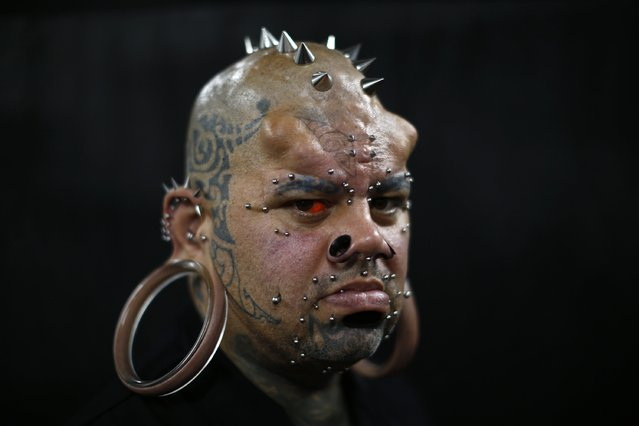 Kala Kaiwi, a tattoo and body modification artist from Hawaii, poses for a picture at Venezuela Expo Tattoo in Caracas January 29, 2015. Kaiwi is a Guinness World Record holder for the largest non-surgically made stretch earlobes, which measure 109mm (4.3 inches) in diameter. (Photo by Jorge Silva/Reuters)