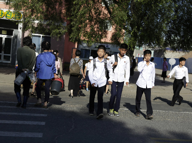 North Korean youths cross a road in Pyongyang, North Korea, Friday, June 22, 2018. (Photo by Dita Alangkara/AP Photo)