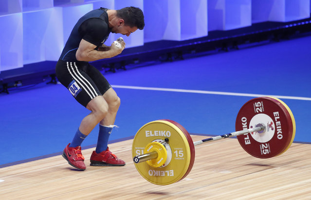 Valentin Iancu of Romania in action during the Men's 55kg category final at the 2021 EWF European Weightlifting Championships, in Moscow, Russia, 04 April 2021. (Photo by Maxim Shipenkov/EPA/EFE)