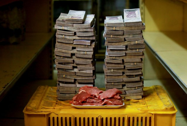A kilogram of meat is pictured next to 9,500,000 bolivars, its price and the equivalent of 1.45 USD, at a mini-market in Caracas, Venezuela August 16, 2018. It was the going price at an informal market in the low-income neighborhood of Catia. (Photo by Carlos Garcia Rawlins/Reuters)