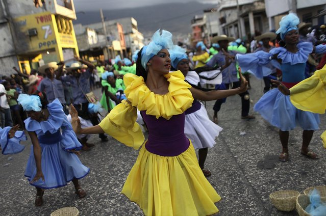 Revellers take part in the National Carnival 2015 annual parade in Port-au-Prince February 15, 2015. (Photo by Andres Martinez Casares/Reuters)
