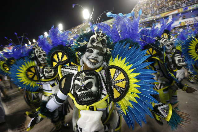 A performer from the Portela samba school smiles during Carnival celebrations at the Sambadrome in Rio de Janeiro, Brazil, Monday, February 16, 2015. (Photo by Silvia Izquierdo/AP Photo)