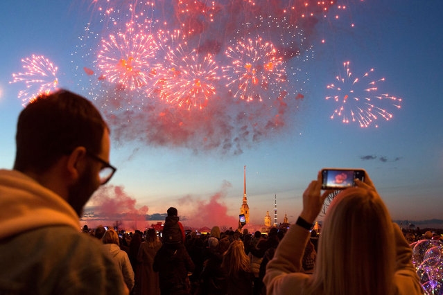 People watch fireworks commemorating the 76th anniversary of the victory in the Great Patriotic War in St. Petersburg, Russia, May 9, 2021. (Photo by Chine Nouvelle/SIPA Press/Rex Features/Shutterstock)