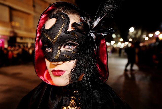 A masked reveller participates in the Carnival in the city of Strumica, February 21, 2015. The event marks Trimery, an Orthodox Christian holiday, when evil spirits are chased away with dance rituals, marking the beginning of the fasting period ahead of Easter. (Photo by Ognen Teofilovski/Reuters)