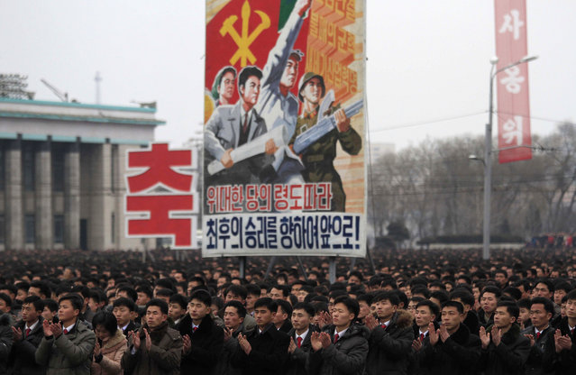 North Koreans gather at the Kim Il Sung Square to celebrate a satellite launch Monday, February 8, 2016, in Pyongyang, North Korea. People in Pyongyang danced and watched fireworks the day after a rocket launch that has been strongly condemned by many countries around the world. (Photo by Jon Chol Jin/AP Photo)