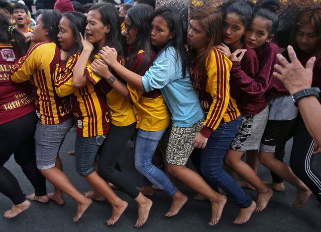 Devotees pull a chariot as they parade a replica of the Black Nazarene, two days before the annual procession to celebrate its feast day in Quiapo, Manila, Philippines, January 7, 2019. (Photo by Eloisa Lopez/Reuters)