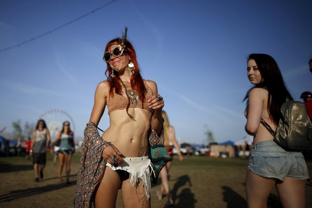Women walk through the Coachella Valley Music and Arts Festival in Indio, California April 10, 2015. (Photo by Lucy Nicholson/Reuters)
