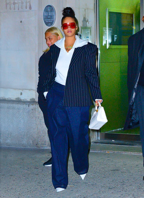 Rihanna was in high spirits as she arrived to see friends at an office tonight in New York on January 14, 2019. She was rocking oversized trousers paired with a pin striped blazer over white hoodie on the outing. (Photo by PapCulture/Splash News and Pictures)