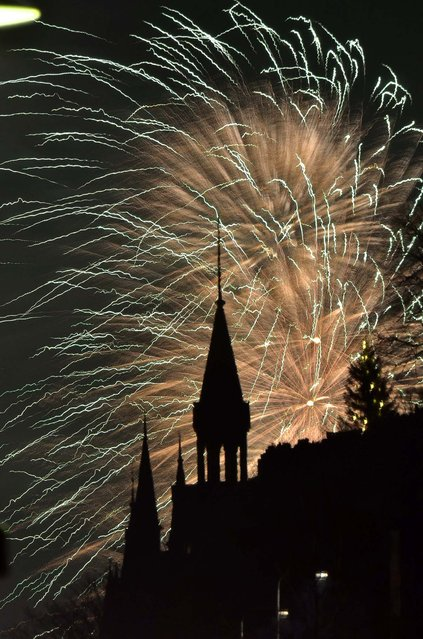 Fireworks backlight Stockholm, Sweden's iconic Slussen spired buildings. (Rob Schoenbaum/Zuma Wire)