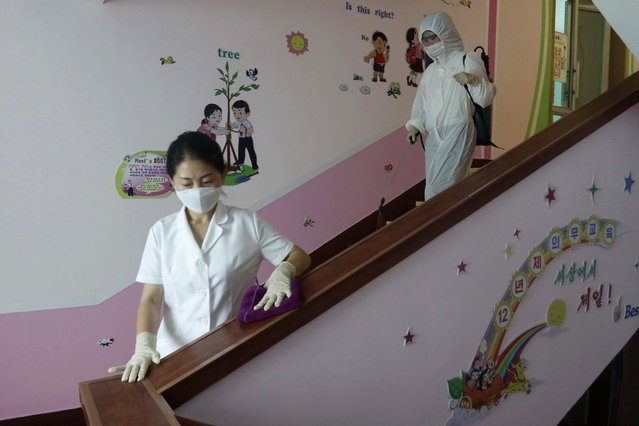 In this  June 30, 2021, file photo, staff of the Pyongyang Primary School No. 4 clean stairwells in Pyongyang, North Korea. There is no sign that North Korean leader Kim Jong Un has been inoculated against the coronavirus and his country hasn't received any foreign vaccines, South Korea's spy agency said Thursday, July 8, 2021. (Photo by Cha Song Ho/AP Photo)