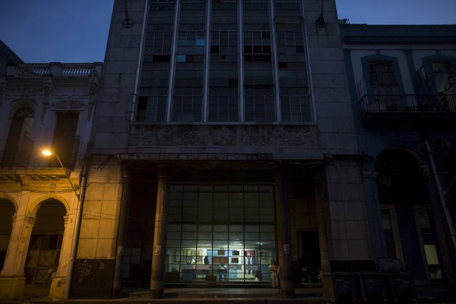 A polling station is seen at dawn before opening for municipal elections in Havana April 19, 2015. (Photo by Alexandre Meneghini/Reuters)
