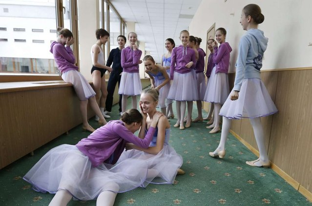 Students rehearse at the concert hall of Moscow State Academy of Choreography in Moscow, on March 3, 2016. (Photo by Yuri Kochetkov/EPA)