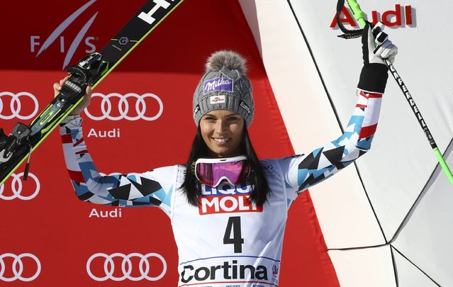 Austria's Anna Veith celebrates her third place in a alpine ski, women's World Cup super-G, in Cortina d'Ampezzo, Italy, Sunday, January 29, 2017. (Photo by Alessandro Trovati/AP Photo)