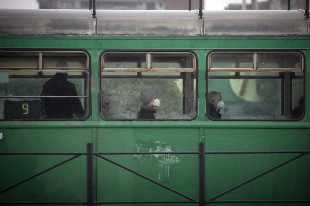 Passengers wearing face masks ride a tram in Belgrade on October 11, 2021, amid the Covid-19 (novel coronavirus) pandemic. Serbia has been averaging more than 6,500 cases a day over the past two weeks, according to AFP data, an infection rate of almost 93,5 per 100,000 people – by far the highest in the world. Packed bars, few masks and almost no restrictions – in Serbia it seems the pandemic is over. But it's a cruel illusion, as the Balkan country currently tops the global charts for infection rates. Despite having a variety of jabs available, the country's vaccination drive stalled after just over 40 percent of its seven-million population were inoculated. (Photo by Oliver Bunic/AFP Photo)