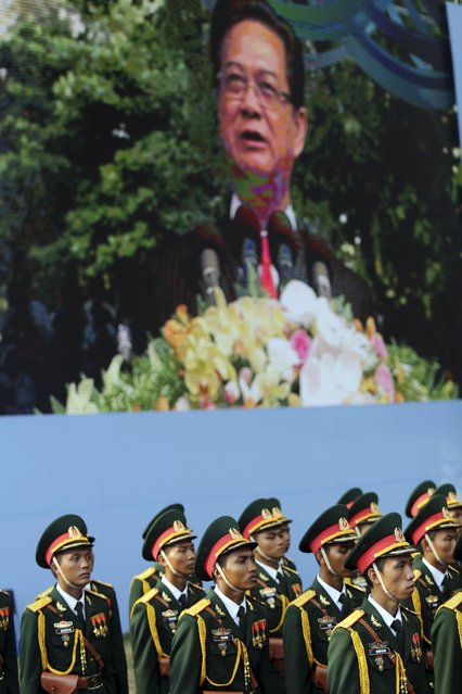 Vietnamese honor guards stand in front of a screen displaying Prime Minister Nguyen Tan Dung giving his speech at a parade celebrating the 40th anniversary of the end of the Vietnam War which is also remembered as the fall of Saigon, in Ho Chi Minh City, Vietnam, Thursday, April 30, 2015. (Photo by Na Son Nguyen/AP Photo)