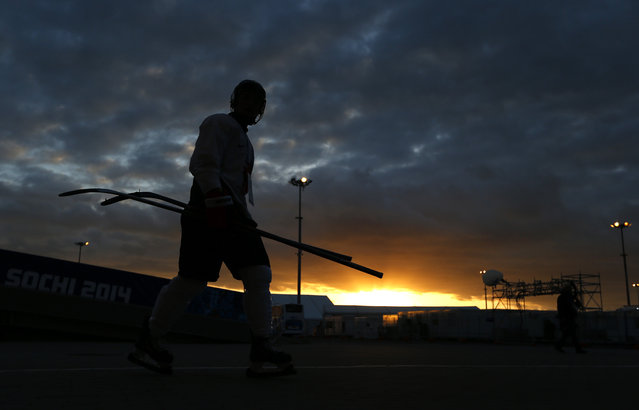 A member of Canada's women's ice hockey team walks in Olympic Park after her practice session ahead of the 2014 Winter Olympics, Tuesday, February 4, 2014, in Sochi, Russia. (Photo by Petr David Josek/AP Photo)