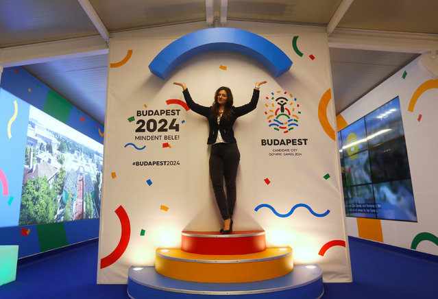 A hostess poses with Hungary's Olympic logo at a promotional spot as the Hungarian capital bids for the 2024 Olympic Games, in central Budapest, Hungary January 31, 2017. (Photo by Laszlo Balogh/Reuters)