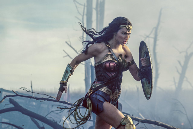 "This image released by Warner Bros. Entertainment shows Gal Gadot in a scene from ""Wonder Woman"". A new study organized by Time's Up, the Hollywood-based organization formed to promote gender equality, finds that female-led films outperform male-led movies at the box office. The study analyzed the 350 top-grossing films worldwide released between January 2014 and December 2017. It found that in films with small, medium and large budgets, all averaged better global grosses when a woman was listed as the lead star. (Photo by Clay Enos/Warner Bros. Entertainment via AP Photo)"