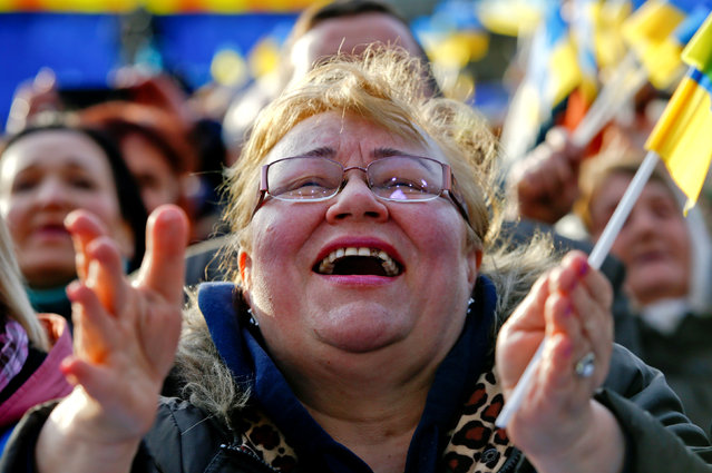 A supporter of Yulia Tymoshenko, leader of opposition Batkivshchyna party and presidential candidate, reacts at her last campaign rally in central Kiev, Ukraine, March 29, 2019. (Photo by Vasily Fedosenko/Reuters)