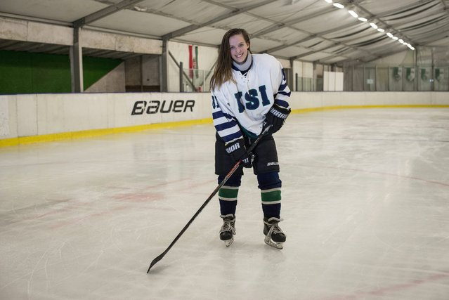 Under 14 ice hockey team of Central Sports School Budapest (KSI) captain Orsolya Soled smiles after a training session played against FTC of Budapest in FTC's ice rink in Budapest, Hungary, 04 March 2016. (Photo by Bea Kallos/EPA)