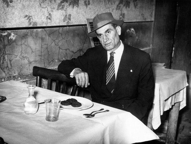 Italian-American mafioso Frank Frigenti sitting at a table in a restaurant. Italy, 1950s. (Photo by Mondadori Portfolio via Getty Images)