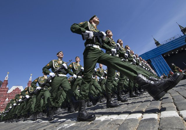Russian army soldiers march along Red Square during a general rehearsal for the Victory Day military parade which will take place at Moscow's Red Square on May 9 to celebrate 70 years after the victory in WWII, in Moscow, Russia, Thursday, May 7, 2015. (Photo by Alexander Zemlianichenko/AP Photo)