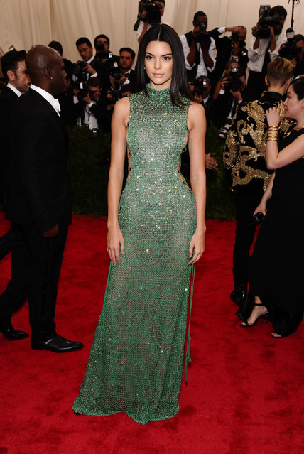 """Kendall Jenner arrives at The Metropolitan Museum of Art's Costume Institute benefit gala celebrating """"China: Through the Looking Glass"""" on Monday, May 4, 2015, in New York. (Photo by Charles Sykes/Invision/AP Photo)"""