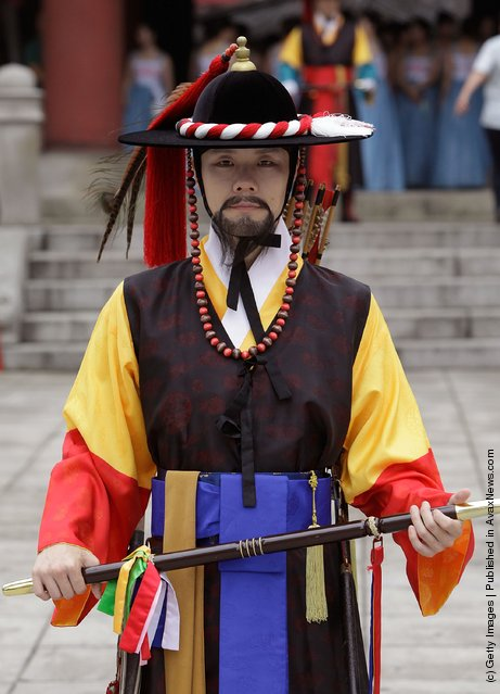 A South Korean man wear traditional costume attend during the 66th Independence Day ceremony in Seoul, South Korea