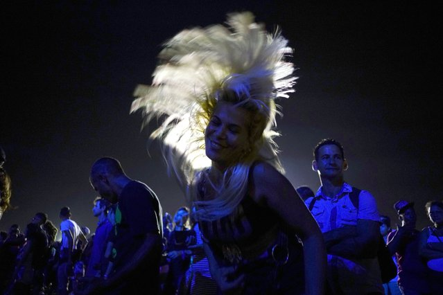 People dance at a Rolling Stones concert in Havana, Cuba, Friday March 25, 2016. (Photo by Ramon Espinosa/AP Photo)