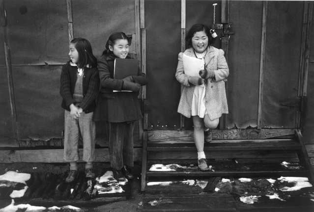 Three school children standing against a wall at the Manzanar War Relocation Center in California, in this 1943 handout photo. (Photo by Courtesy Ansel Adams/Library of Congress, Prints and Photographs Division/Reuters)