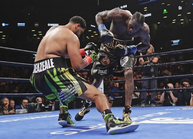 Deontay Wilder, right, knocks down Dominic Breazeale during the first round of the WBC heavyweight championship boxing match Saturday, May 18, 2019, in New York. Wilder stopped Breazeale in the first round. (Photo by Frank Franklin II/AP Photo)