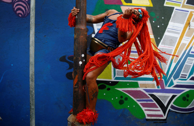 """A reveller takes part in an annual block party known as """"Ceu na Terra"""" (Heaven on Earth), one of the many carnival parties to take place in the neighbourhoods of Rio de Janeiro, Brazil February 25, 2017. (Photo by Ricardo Moraes/Reuters)"""