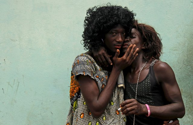 Men dressed as women kiss as they take part in a parade during the Popo (Mask) Carnival of Bonoua, east of Abidjan, April 9, 2016. (Photo by Luc Gnago/Reuters)